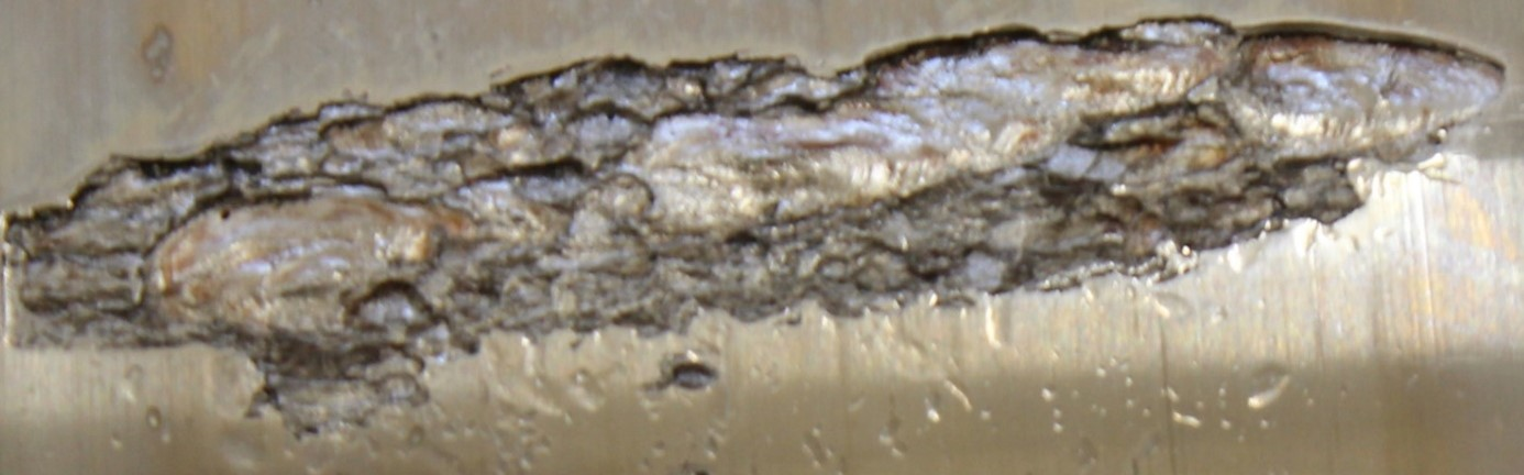 Close up of a damaged area showing a combination of fatigue and embrittlement damages